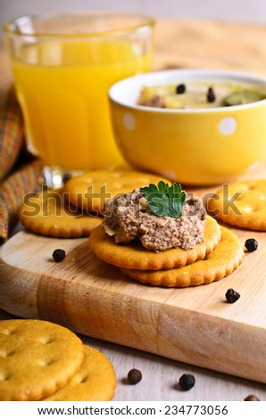 Sandwich with meat pate on a wooden board - stock photo