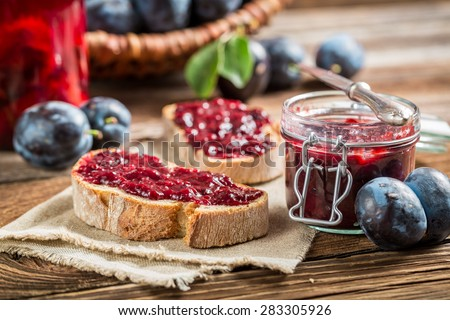 Sandwich with plum jam - stock photo