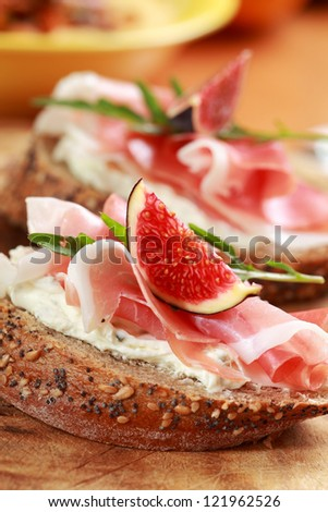Sandwich with prosciutto, goat cheese and fig - stock photo