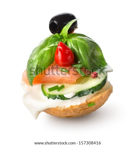 Sandwich with red fish and vegetables isolated on white - stock photo