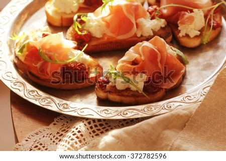 sandwich with ricotta, prosciutto and tomatoes - stock photo