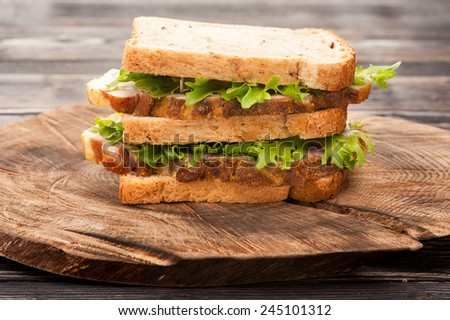 Sandwich with roasted pork and lettuce - stock photo