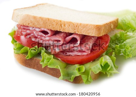 sandwich with salami and lettuce