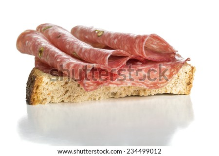 Sandwich with salami sausage on white background - stock photo