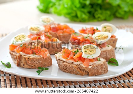 Sandwich with salted salmon and cream cheese. - stock photo