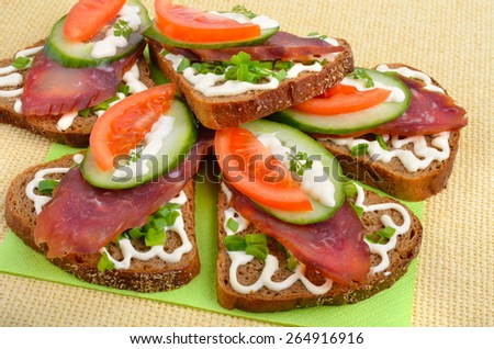 Sandwich with smoked meat and vegetables on  the sacking - stock photo