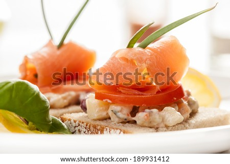 Sandwich with smoked salmon and vegetable salad