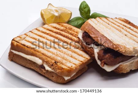 sandwich with some grilled sausages and cheese - stock photo