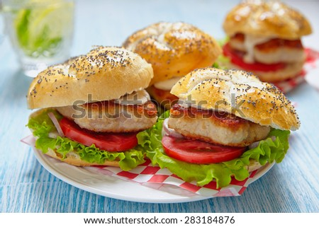 Sandwich with tomato, salad and star shape chicken burger - stock photo
