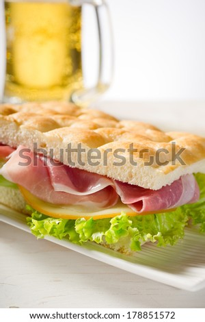 sandwich with white pizza and turkey ham