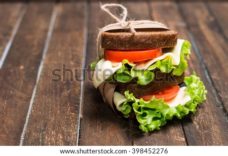 Sandwiches on rustic wooden table with copyspace for your text. Healthy eating breakfast concept, food background.  - stock photo