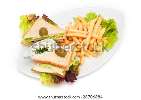 sandwiches with fries and sauce on plate - stock photo