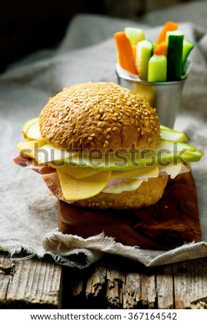 sandwiches with ham ,cheese and pear. style vintage. selective focus