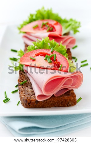Sandwiches with Ham, Lettuce and Tomato - stock photo