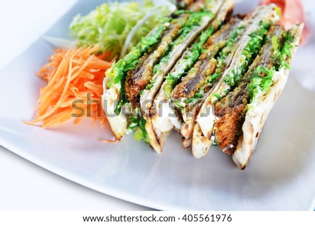 sandwiches with meat and vegetables on  plate - stock photo