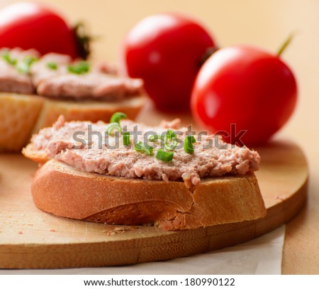Sandwiches with paste and green onions. Served with cherry tomatoes. - stock photo