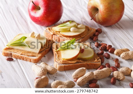 sandwiches with peanut butter and an apple on the table. horizontal  - stock photo
