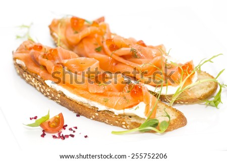 sandwiches with salmon caviar and greens adorned - stock photo
