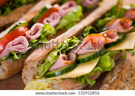 Sandwiches with swiss cheese, ham and vegetables - stock photo