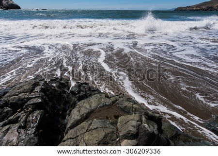 Sandy and rocky beach on the west coast of California USA - stock photo