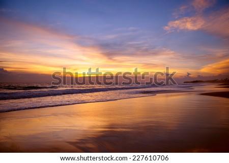 sandy beach and a beautiful sunset - stock photo