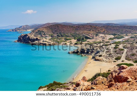 Sandy beach and lagoon with clear blue water at Crete island near Sitia town, Greece.