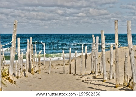 Sandy beach and ocean at Cape Cod - stock photo
