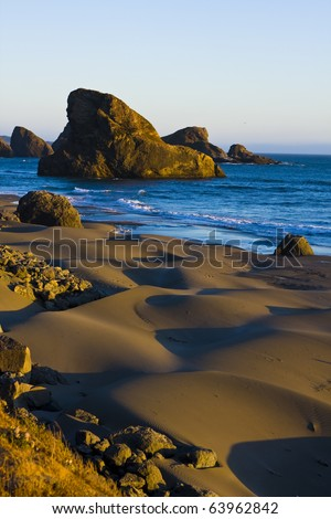 Sandy beach at sunset on the Oregon coast - stock photo