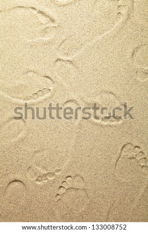 Sandy beach background with footprints for summer - stock photo