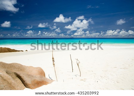 Sandy beach, barbed rocks, turquoise sea, tropical landscape