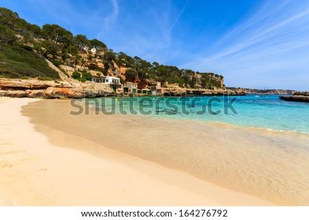Sandy beach in beautiful bay with azure sea water, Cala Llombards, Majorca island, Spain - stock photo