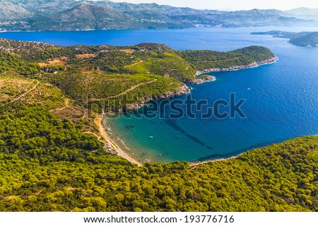 Sandy beach on Elaphites island Lopud with a view to the Dubrovnik archipelago. - stock photo