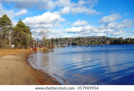 Sandy beach on Oxtongue Lake in Ontario, Canada - stock photo