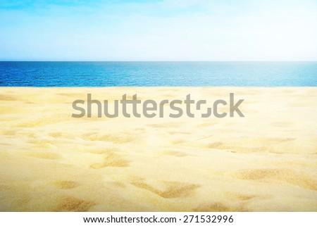 Sandy beach on sunny day - stock photo