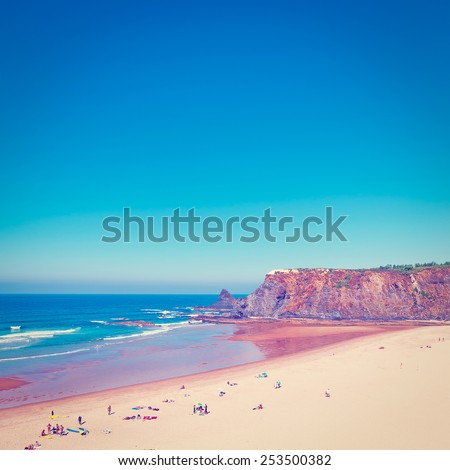 Sandy Beach on the Rocky Coast of Atlantic Ocean in Portugal, Instagram Effect - stock photo