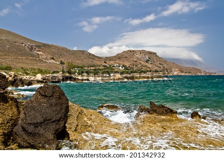 sandy beach with rocks in Crete, Greece