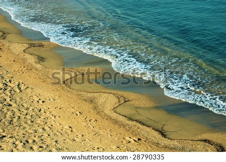 sandy coast of mediterranean sea - stock photo