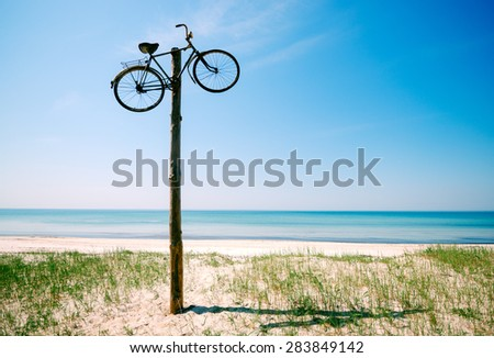 sandy coastline on a sunny day, summer holiday by the water, an unforgettable holiday - stock photo