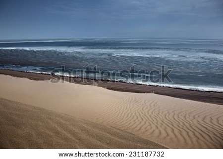 Sandy desert and sea. Horizontal photo - stock photo