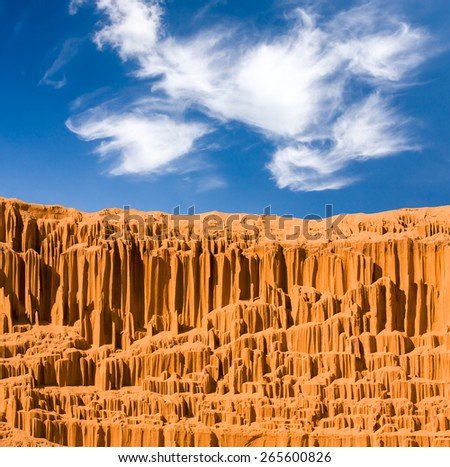 Sandy desert landscape with nice sky and clouds - stock photo