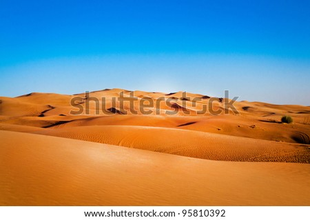 sandy desert on background of blue sky - stock photo