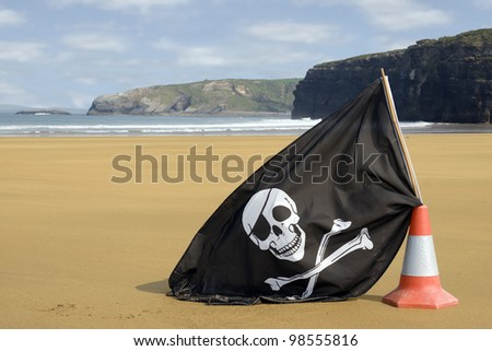 sandy golden beach with jolly roger flag in ballybunion county Kerry Ireland - stock photo