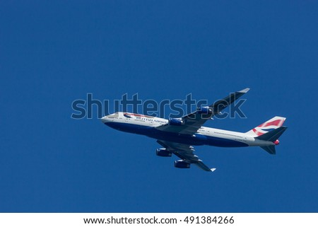 SANDY HOOK, NJ - April 17, 2016: A British Airways commercial jet flies over Sandy Hook on a bright spring day.