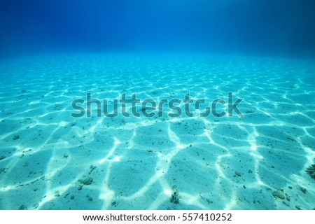 Sandy sea floor with structure of sunlight in the red sea