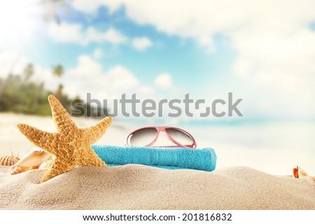 Sandy summer beach with blur sea on background - stock photo