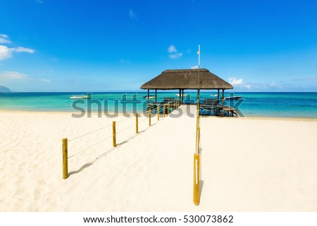 Sandy tropical Wolmar beach at sunny day. Jetty on the foreground.  Mauritius