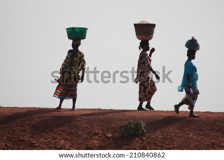 SANGA, MALI - SEPTEMBER 29 , 2008:  Unidentified women from village in Dogon country on september 29, 2008, Sanga, Mali - stock photo