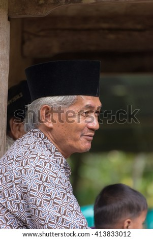 Sangalla, Indonesia - September 8, 2014: Mature man of Toraja ethnicity in traditional attire in the village of Sangalla, Tana Toraja, Sulawesi, Indonesia. - stock photo