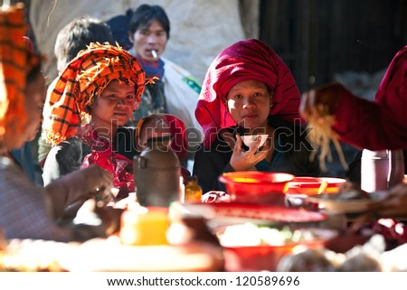 SANGHAR, MYANMAR - JANUARY 15: An unidentified Pa-O tribe women posing for the photo during the local Htamanu Festival on January 15, 2011 in Sanghar Village, Shan state, Myanmar - stock photo