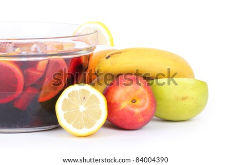Sangria in glass bowl, closeup on white - stock photo